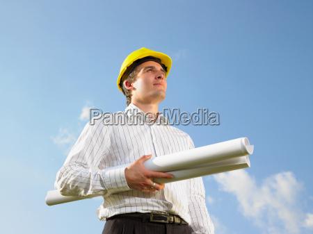 surveyor in front of blue skies