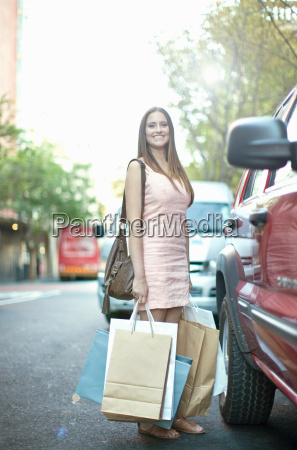 young woman with shopping bags next