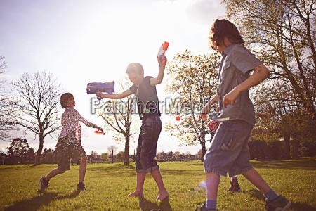 boys playing with foam dart guns