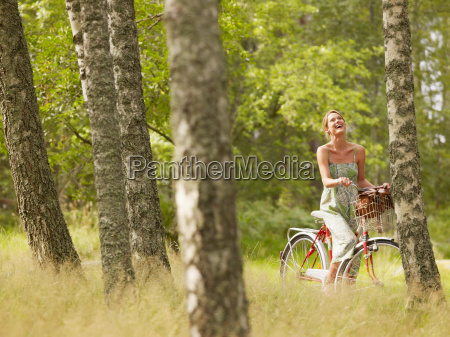 woman riding a bike in forest