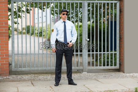 male security guard standing at the