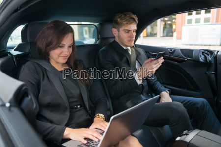 young businessman and businesswoman traveling in