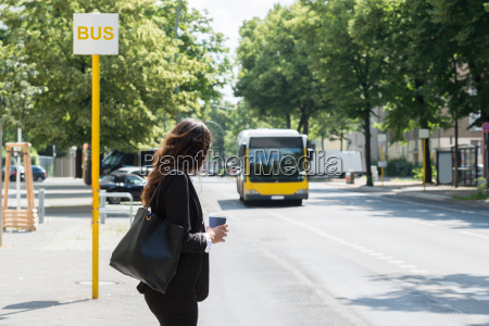 businesswoman waiting for bus