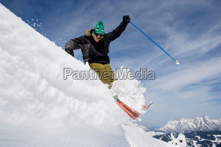 skier jumping of a cornice