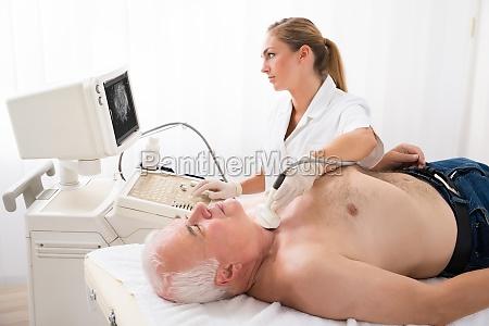 man getting ultrasound scan on neck