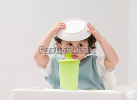 a boy with his food bowl