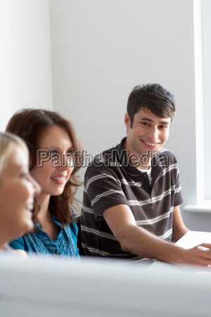 office workers in meeting smiling