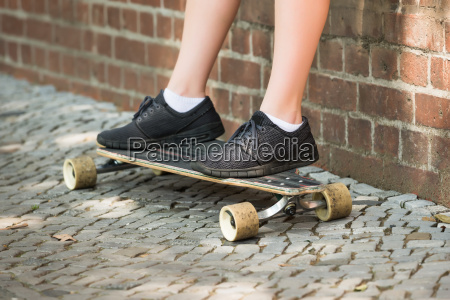 boys feet on skateboard