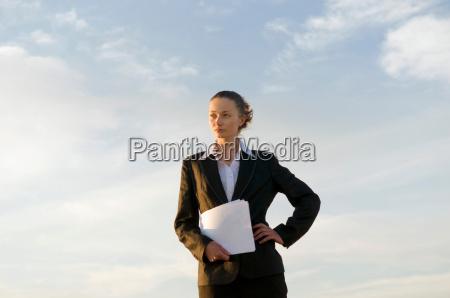 business woman shot against sky