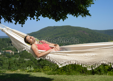 girl asleep in hammock