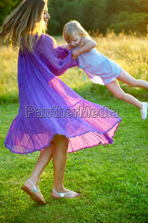 girl and woman dancing outdoors