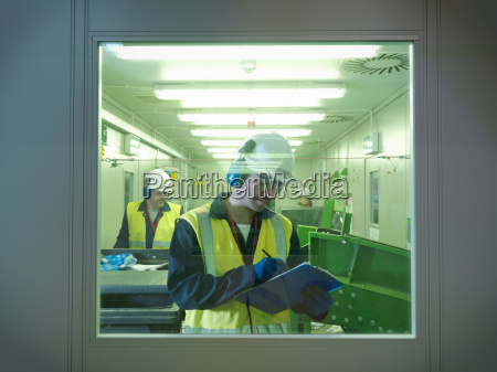 workers separating waste in plant