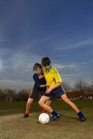 two men playing football
