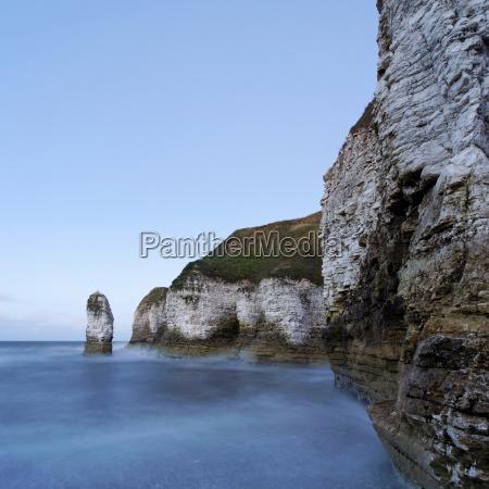 rocky cliffs by sea