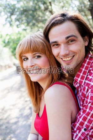 young couple smiling to camera