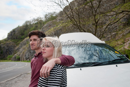 couple with motor home by road