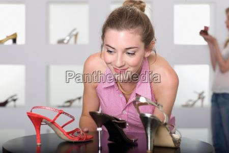 young woman in shoe shop