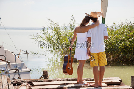 couple looking out over lake
