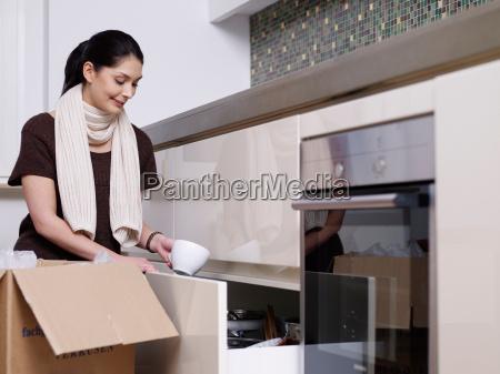 young women unpacking boxes