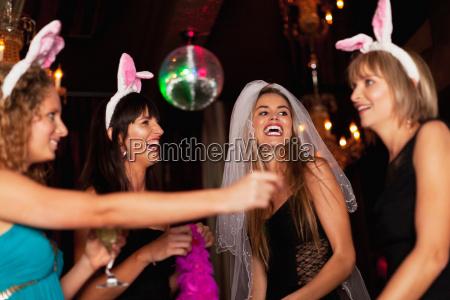 women having bachelorette party in bar