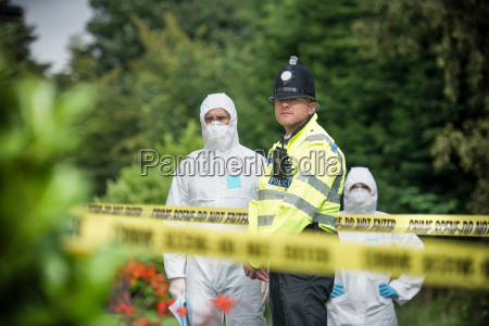 policeman and forensic scientists at crime