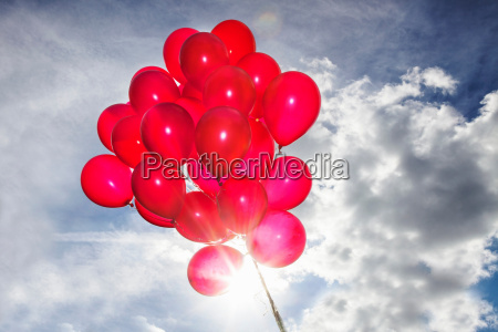 bunch of red balloons in blue