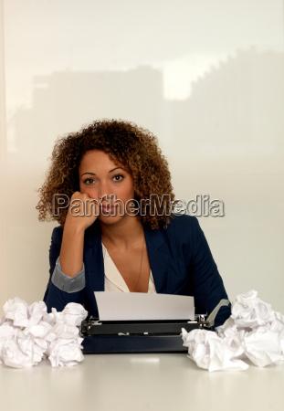 businesswoman using typewriter