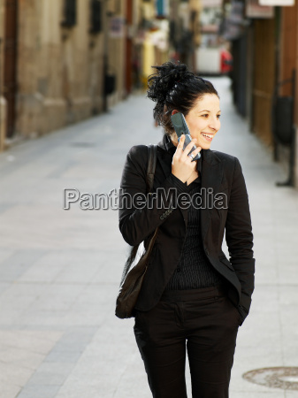 young woman walking in street on
