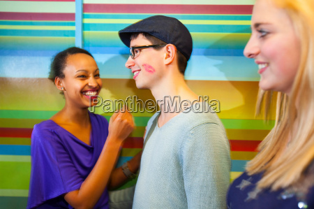 young man with lipstick mark on