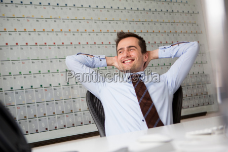 businessman leaning back in chair with
