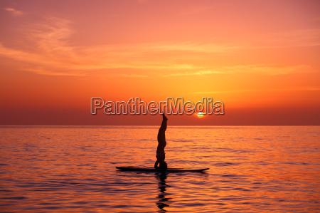 yoga trainer on the beach