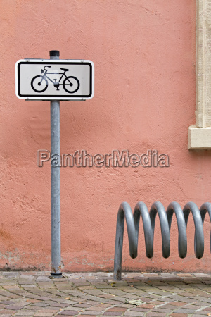 cycle of metal and a sign