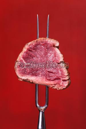 steak on a serving fork