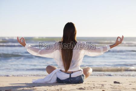 young woman doing yoga on the