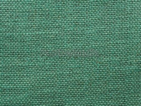 green burlap fabric texture background
