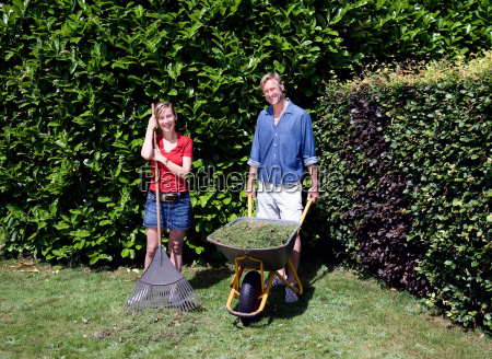 portrait of couple with garden tools