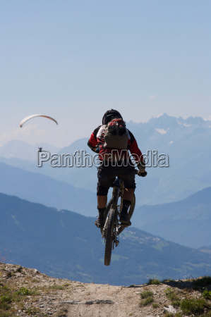mountain biker jumping into the air