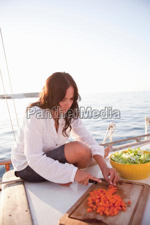 woman on boat preparing food