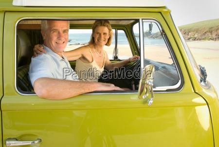 mature couple sat in camper van