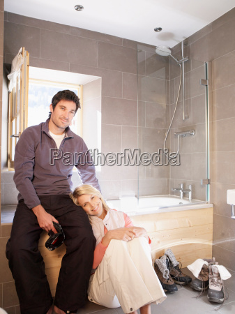 woman and man in chalet bathroom