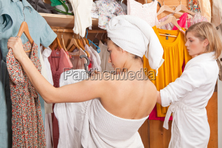 women in bathrobes in front of