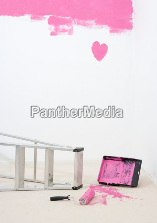 painted heart on wall and spilt