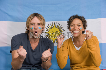 couple smiling with argentinian flag