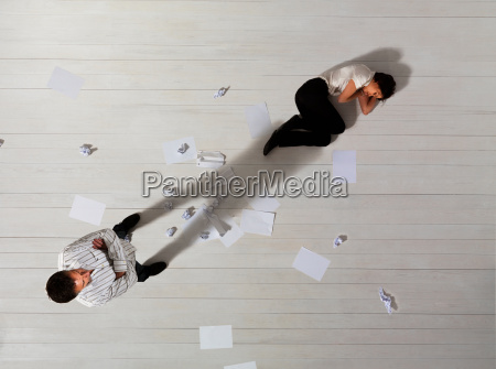 business man standing over woman