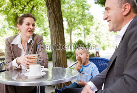 business couple with son in outdoor