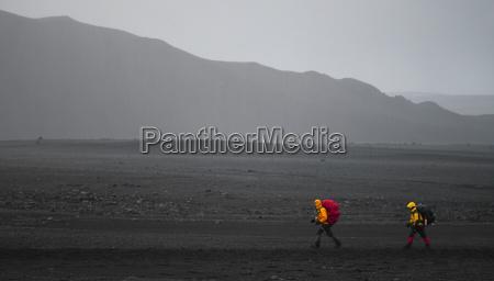 hikers walking in rural landscape