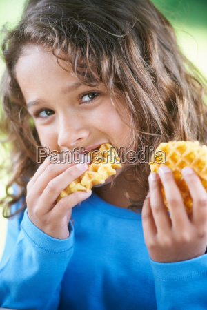 smiling girl eating waffles