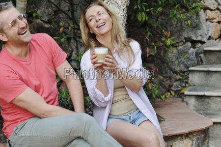 couple laughing together in backyard
