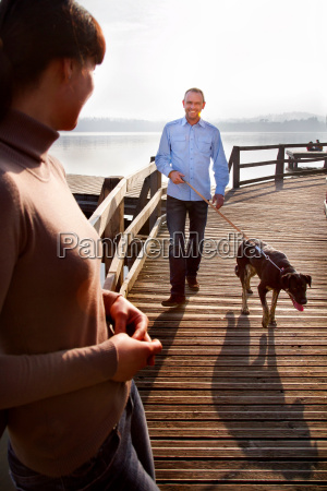 couple, walking, dog, on, pier - 18318906
