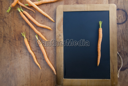 carrot on blackboard still life